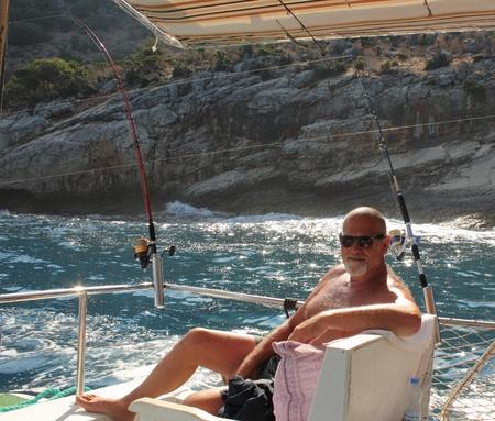 oludeniz: A man on a fishing trip in Turkey, oludeniz 2014