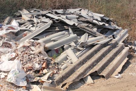 Asbestos waste dumped on open land photo