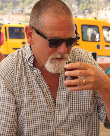 englishman: An englishman drinking turkish tea while in turkey