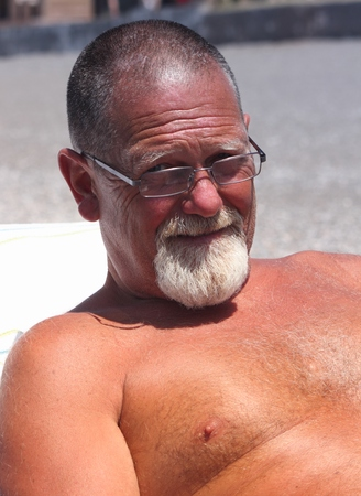 englishman: A tanned englishman relaxing on holiday Stock Photo