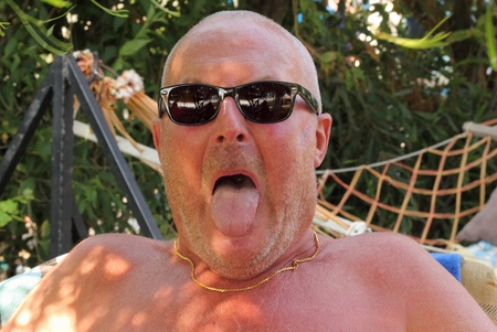 englishman: An englishman wearing sunglasses in the sunshine while on vacation 2014