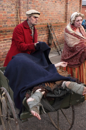 dockyard: Unknown actors playing the parts of victorians collecting the dead at the yearly Christmas victorian festival in portsmouth dockyard, 2014