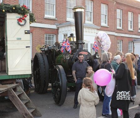 dockyard: 30TH NOVEMBER 2014, PORTSMOUTH DOCKYARD, ENGLAND:  An owner with his steam engine at the yearly Christmas Victorian festival held in Portsmouth dockyard, England 30th November 2014