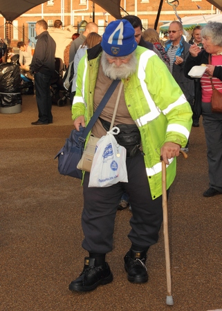 dockyard: 30TH NOVEMBER 2014, PORTSMOUTH DOCKYARD, ENGLAND: An unknown old man looking scruffy visiting the yearly victorian christmas festival in portsmouth dockyard, england, 30th november 2014