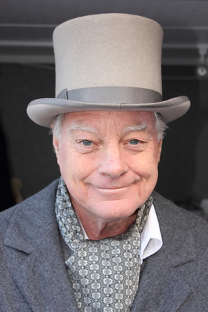 dockyard: An unknown actor playing the part of a victorian gentleman at the yearly Christmas victorian festival in portsmouth dockyard, 2014