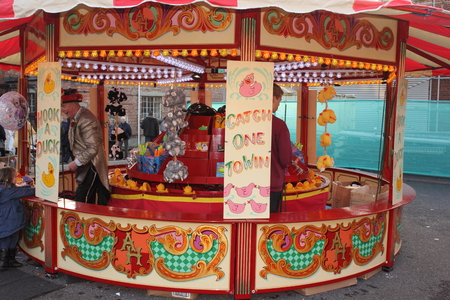 30TH NOVEMBER 2014, PORTSMOUTH DOCKYARD, ENGLAND: A retro fairground attraction at the yearly victorian christmas festival held in portsmouth dockyard, england, 30th november 2014