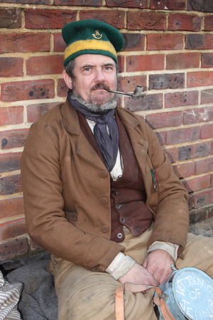 Unknown actor playing the part of a victorian soldier at the yearly Christmas victorian festival in portsmouth dockyard, 2014