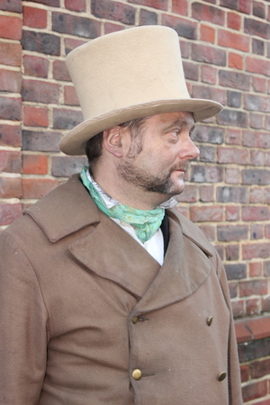 fayre: Unknown actor playing the part of a victorian gentleman at the yearly Christmas victorian festival in portsmouth dockyard, 2014 Editorial