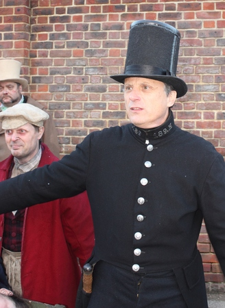 loitering: Unknown actors playing the parts of victorians at the yearly Christmas victorian festival in portsmouth dockyard, 2014