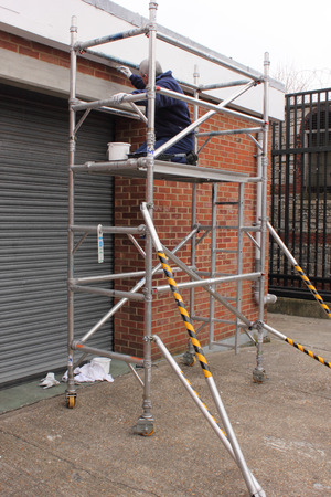 scaffold: A painter working from a scaffold tower