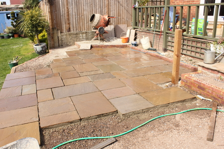 The construction and Building of a natural stone patio in an english garden