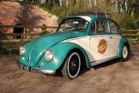 cherished: A 50 year old retro vw beetle car fitted with a sunvisor and has been lowered, in portsmouth england, 12th april 2015