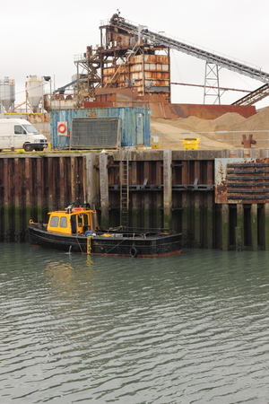 aggregates: Aggregates being delivered by sea to portsmouth in england, 2015 Editorial