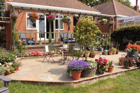 architecture bungalow: An English garden in full bloom Stock Photo