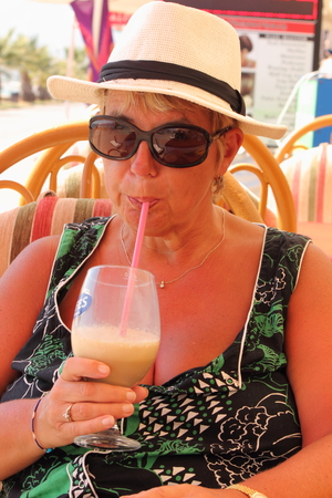 refreshment: An english lady having refreshment while on vacation