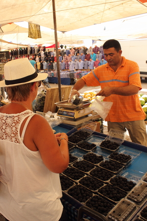 travelling salesman: CALIS, TURKEY, JULY 2015: An english lady buying fresh blackberries from a trader at a local turkish market in calis, turkey, july 2015