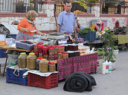 turkish people: Turkish people selling fresh food produce at a local market along the road in calis in turkey, 19th july 2015 Editorial