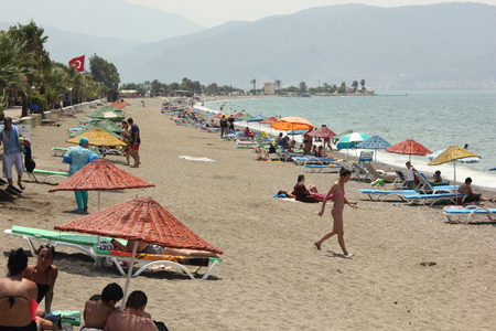turkey beach: Sunbeds and umbrellas at Calis beach in Turkey,2015 Editorial