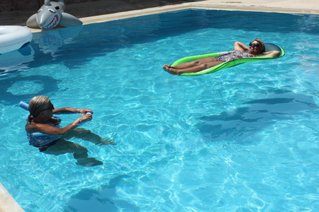 lilo: An english lady relaxing in a swimming pool while on vacation in turkey, august 2015