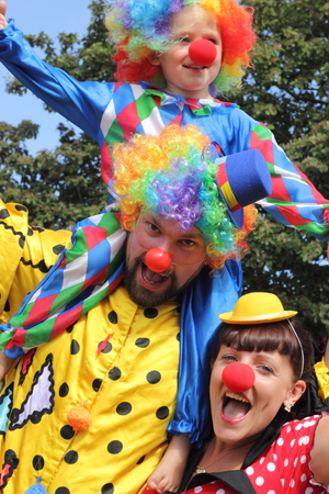 summers: A young family dressed as clowns on a summers day
