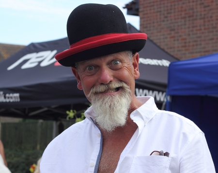 An englishman with a white beard wearing a funny hat Stock Photo