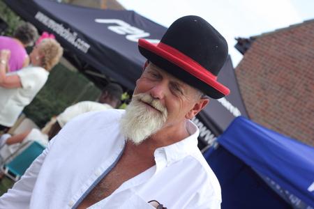 englishman: An englishman with a white beard wearing a funny hat Stock Photo