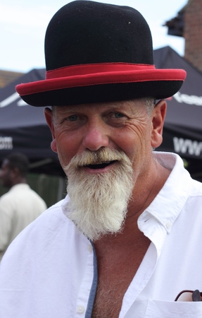 white beard: An englishman with a white beard wearing a funny hat Stock Photo