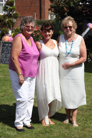 grand daughter: A young grand daughter with  her two  grandmothers on a summers day in england