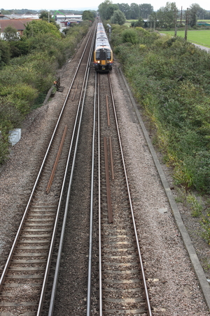 september 9th: PORTSMOUTH, ENGLAND, 9TH SEPTEMBER 2015: A train travelling along the rail track in Portsmouth, England,9th September 2015