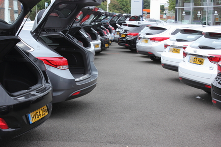 11th: PORTSMOUTH, ENGLAND, 11TH MAY 2015: Cars for sale in a garage lot in Portsmouth, England, 11th may 2015