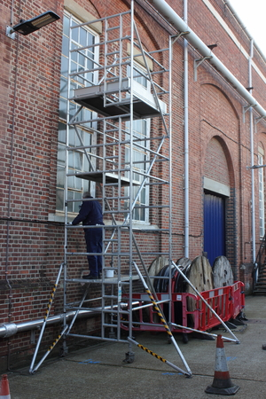 scaffold: A painter and decorator working from a scaffold tower