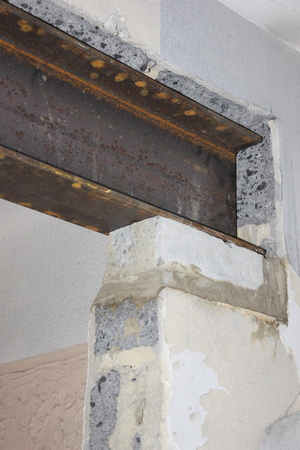 An rsj sitting in place on a concrete pad taking the weight of a load bearing wall