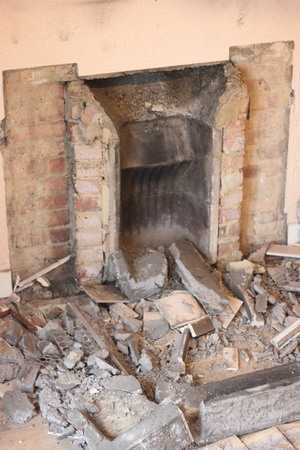 replaced: An old fireplace being removed to be replaced with new Stock Photo