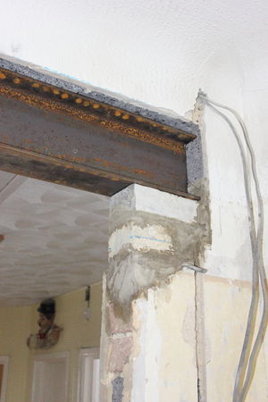 joists: An rsj sitting in place on a concrete pad taking the weight of a load bearing wall