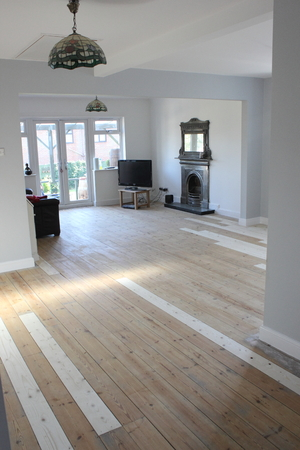 floorboards: A Contemporary living area being decorated with white walls and floorboards ready to be painted Stock Photo