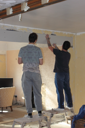 skimming: PORTSMOUTH, ENGLAND, 12TH MARCH 2016: Two plasterers boxing in two newly installed rsjs and getting ready for plastering in portsmouth, england, 12th march 2016