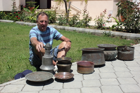 englishman: 28TH MAY 2016, CALIS, TURKEY : An Englishman with his purchase of old antique copper pots which he bought in Calis in Turkey, 28th may 2016