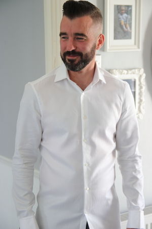 englishman: An englishman wearing a white shirt