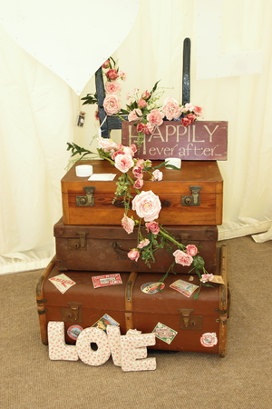 showpiece: Old fashioned suitcases dressed with flowers as a vintage decoration showpiece for a wedding