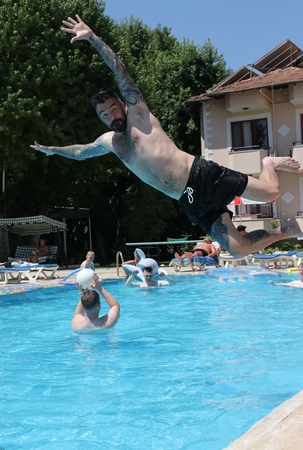 englishman: 14TH JULY 2016,CALIS,TURKEY;An englishman jumping into a swimming pool while on vacation in calis in turkey,14th july 2016 Editorial