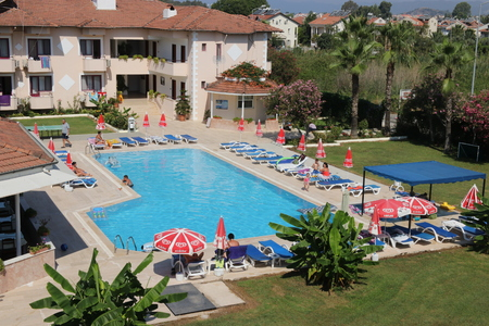 CALIS, TURKEY, 15TH JULY 2016: A local family run hotel business with the swimming pool in the foreground in calis ,turkey, 15th july 2016