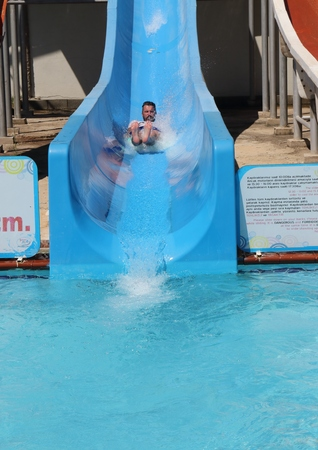 englishman: An englishman having fun on a water slide in a waterpark while on vacation in turkey Stock Photo