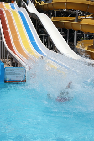 A father and son having fun on a water slide in a waterpark while on vacation in turkey, 2016 photo