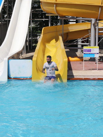 englishman: An englishman having fun on a water slide in a waterpark while on vacation in turkey, 2016