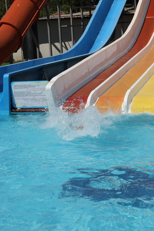 An englishman having fun on a water slide in a waterpark while on vacation in turkey photo