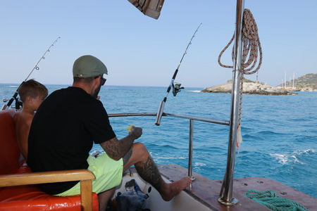 A father and son on a fishing trip in turkey, 2016 photo