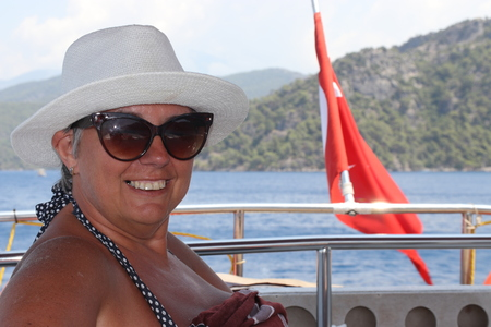 fethiye: An english lady relaxing while on a boat trip around the bays at fethiye in turkey Stock Photo