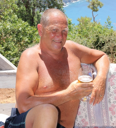 englishman: An englishman relaxing in the sunshine with a drink while on vacation, 2016