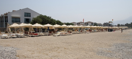 31st: CALIS, TURKEY, 31ST JULY 2016:Umbrellas and sunbeds along Calis beach in Turkey,31st july, 2016 Editorial