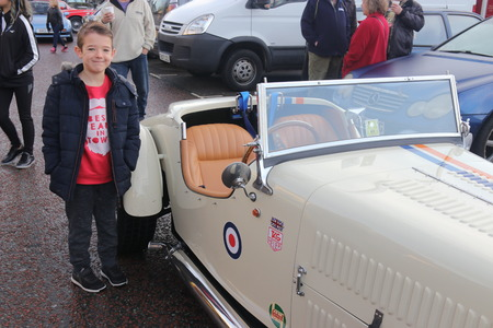 hants: 26TH DECEMBER 2016,WICKHAM,HANTS: A young boy standing next to an old retro car at a classic car show in wickham, england on the 26th december 2016 Editorial